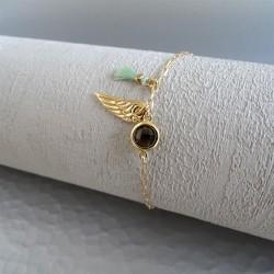 Bracelet solitaire fumé aile et pompon vert