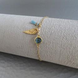 Bracelet solitaire bleu aile et pompon bleu